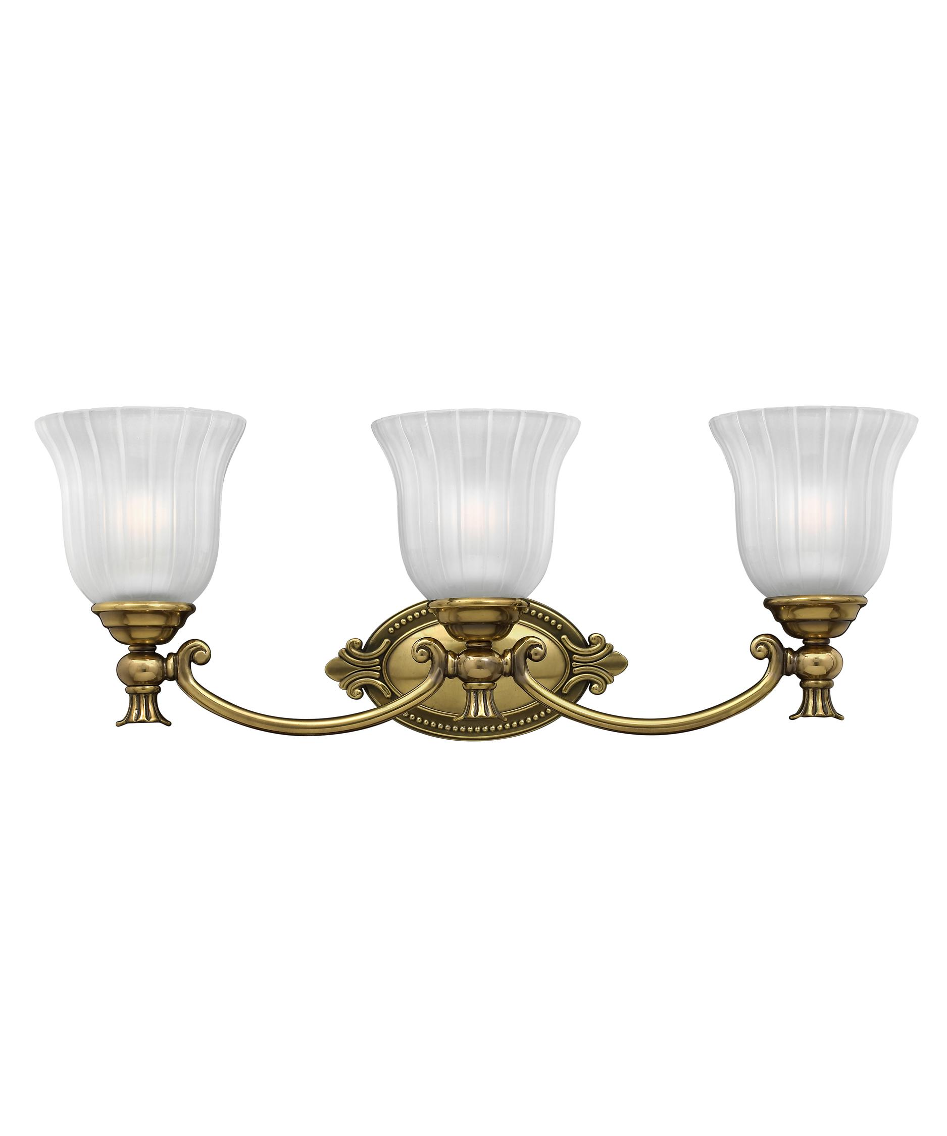 shown in burnished brass finish and ribbed and frosted glass bathroom vanity lighting 1