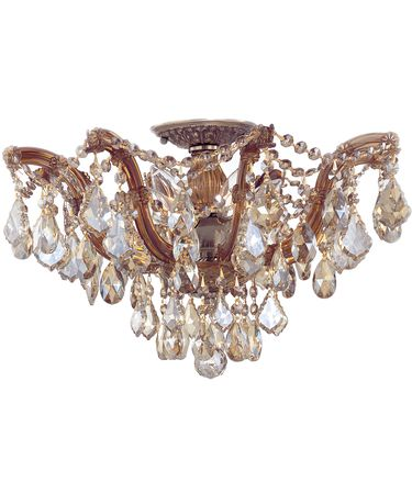 Shown in Antique Brass finish and Golden Teak Hand Polished crystal